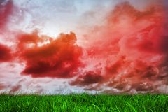 Green grass under red cloudy sky Stock Images
