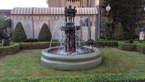 Water fountain statue grass Stock Photos
