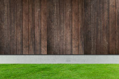 Green grass with white concrete and wood fences Royalty Free Stock Photography