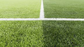 Green grass with white line of football field.  Royalty Free Stock Photography