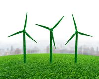 Green grass in wind turbines shape on meadow stock images