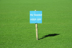 Green Grass With A Sign Royalty Free Stock Photos