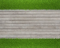 Green grass on wood floor background Stock Photography