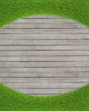Green grass on wood floor background Royalty Free Stock Photo