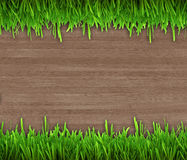 Green grass on wooden background Royalty Free Stock Images