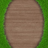 Green grass on wooden background Stock Photography