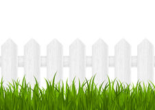Green grass. With wooden fence Royalty Free Stock Photo