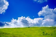 Green grassland and clouds Royalty Free Stock Images
