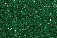 Green grassy background with glitter on macro. stock photography