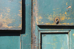 Green gray paint mottled wooden doors Royalty Free Stock Photos