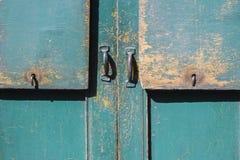 Green gray paint mottled wooden doors Stock Images