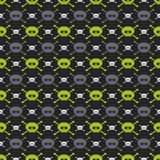 Green, gray and white skulls over dark background. Seamless pattern with green, gray and white skulls over dark background Stock Photo