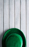 Green: Green Velvet Derby Sits On Wood Background Royalty Free Stock Photos