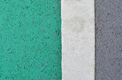 Green and grey asphalt road with white painted stripe. Green and grey asphalt road texture with white painted stripe Royalty Free Stock Photo