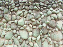 Green grey stone wall background. Green grey stone wall as a background Stock Images