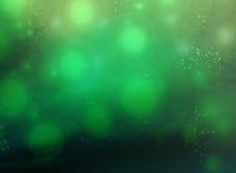 Green Grunge Background. Background of dark green grunge design with bright splatters of light royalty free stock photos