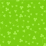 Green grunge clover backgrounds. Green St. Patrick`s day pattern with clover leaves over grunge background stock illustration