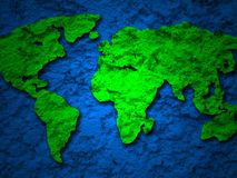 Green grunge earth map on a blue 1 Royalty Free Stock Image