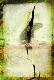 Green grunge frame with big crack in the wall royalty free stock photography