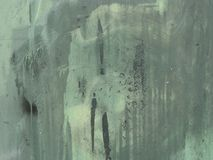 Green grunge metal surface with paint leak marks Stock Images