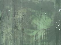 Green grunge metal surface with paint leak marks Royalty Free Stock Photos