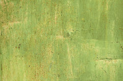 Green grunge painted tin surface Royalty Free Stock Photo