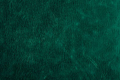 Green grunge scratched leather to use as background Stock Photo