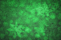 Green grunge textured snowflakes abstract background Royalty Free Stock Photos