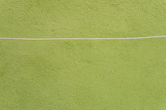Grunge green wall with rope Stock Images