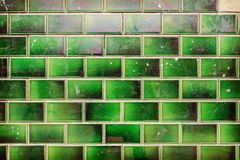 Green grungy tile wall background or texture Stock Photo