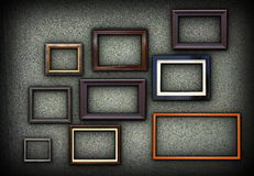 Green grungy wall full of frames Royalty Free Stock Photos