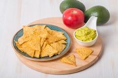 Green Guacamole with nachos and avocado Stock Photos