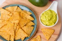 Green Guacamole with nachos and avocado Royalty Free Stock Photos