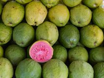 Green guava or pink guava showcase for sale at fair, fresh produce and rich in vitamin A stock photos