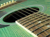 Green guitar. Detail of guitar sound board Stock Photography