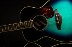 Green guitar on black with reflection stock image