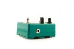 Green guitar effects pedal. On the white Royalty Free Stock Photos