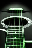 Green guitar strings Stock Images