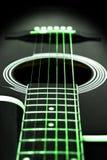 Green guitar strings Stock Images