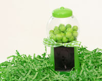 Green Gumball Machine. With gumballs and shredded paper on white backgroung royalty free stock photography