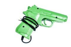 GREEN GUN ISOLATED ON A WHITE. A toy joystick of gun isolated on white royalty free stock photo