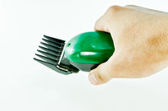 Green Hair clipper. Hand holding Green Hair clipper stock image