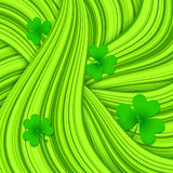 Green hair waves abstract background with clovers Royalty Free Stock Photos