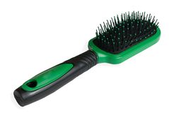 Green hairbrush. On a white background Royalty Free Stock Photos
