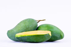 Green half  mango peeled and two fresh  green mangoes on white background healthy fruit food isolated Stock Photography