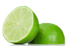 Green halved lemon. On a white background Stock Photography