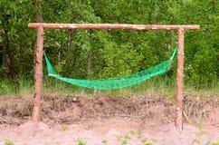 Green hammock on the gate. In the garden Stock Photo