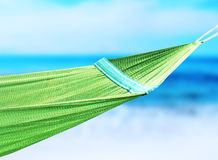 Green hammock hanging in the coast Stock Image