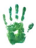 Green hand. Green paint covered hand print on white paper - isolated Stock Images