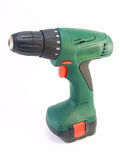 Green hand drill. On battery on a white background Stock Photography